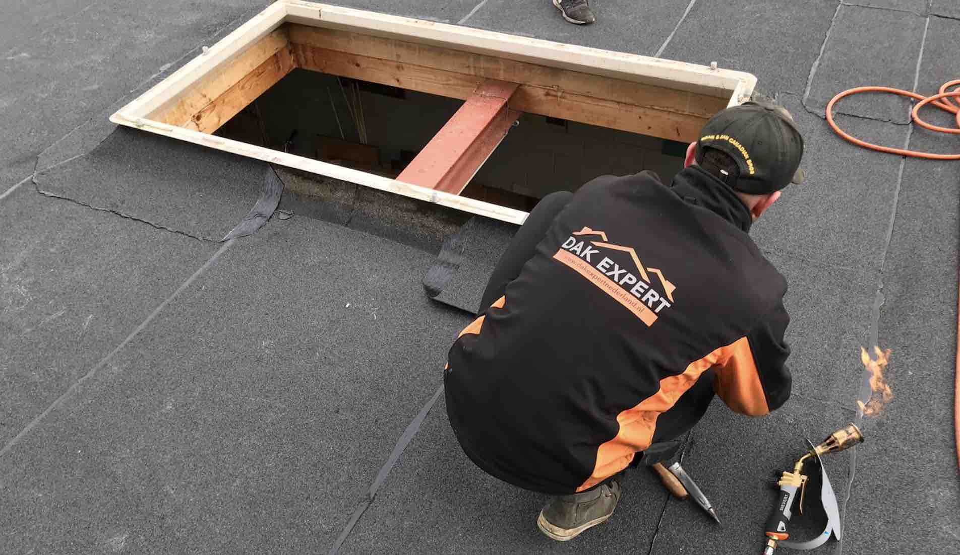 Plat dak vervangen